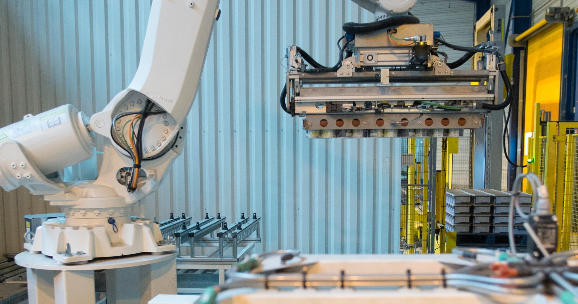 Bras robotisé de conditionnement produit